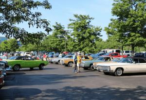 cars lined up at a lambda car club exhibition